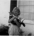 Terry as a child with her cat